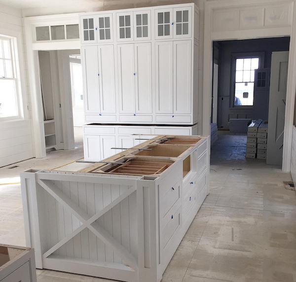 Artisan Signature Homes installing cabinets